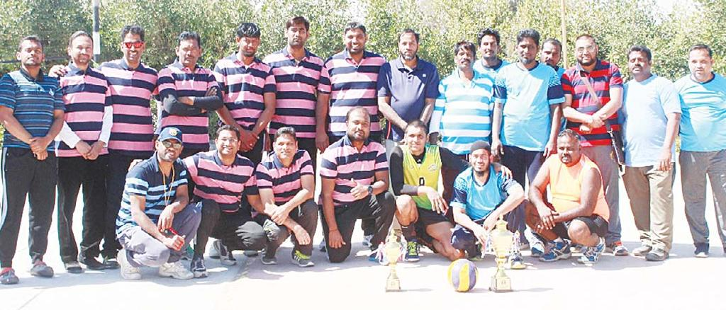 SPORTS 40 Left to right: Participating team pose for a group photo during the IGC s 3rd annual Volleyball tournament.