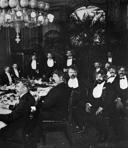 Strive mightily, but eat and drink as friends, Shakespeare advised. These men at a 1901 banquet for New York theatrical producer Harrison Fiske implemented the advice with gusto.