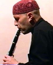 The striking influence of Argentinean esthetics is a hallmark of the Crakow Klezmer Band s sophisticated arrangements. Old Oleg Dyyak, playing his clarinet.