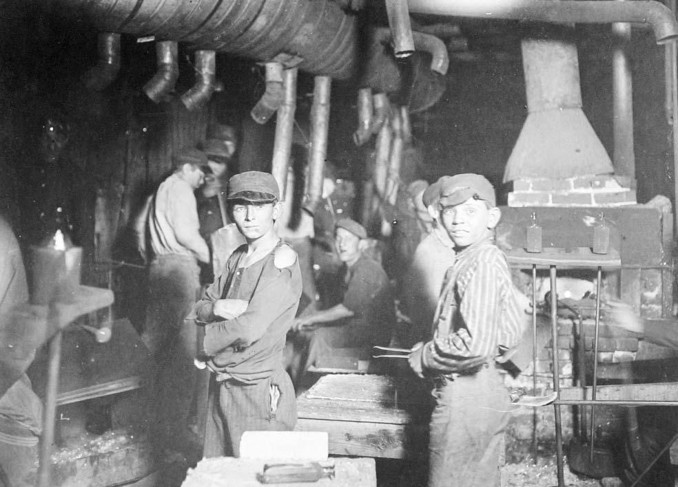 Document 3 Lewis Hine took this photograph at the Indiana Glass Works in 1908. He noted that the time he took the picture was midnight. 18. Describe what you see in this picture. 19. What are some of the abuses and problems that progressive reformers sought to address?