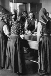 Hutterite Society Cooperation is valued in Hutterite society, where community members worship, work, and eat as a group.