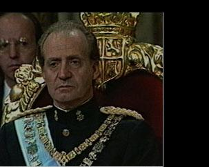 Spain Carlos announces constitutional monarchy in coronation speech.