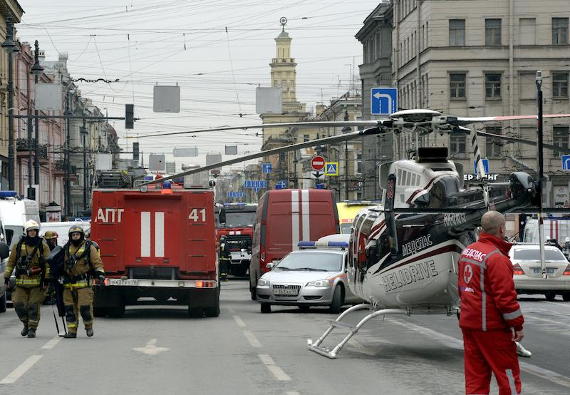 Emergency services personnel and vehicles are seen at the entrance to Technological Institute metro station in St. Petersburg on April 3, 2017.