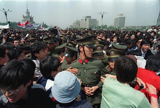Tiananmen Square protests of 1989 - Protests escalate 100,000 students and workers marched in Beijing making demands for free media reform and a formal