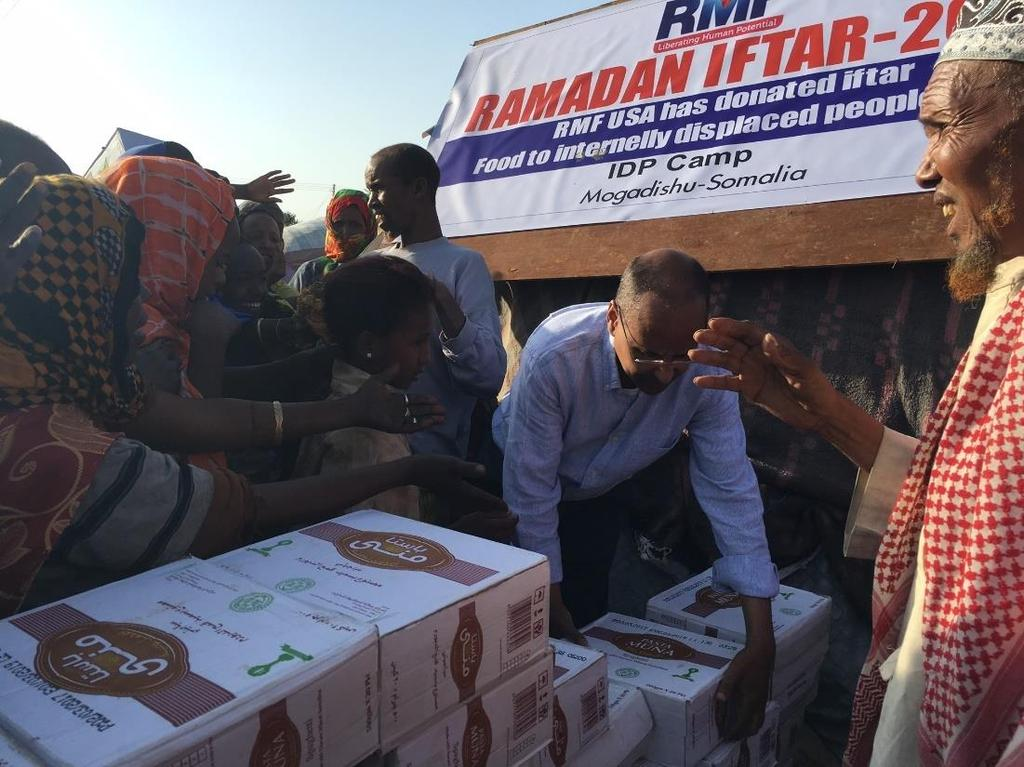 Abib hands out food packages to