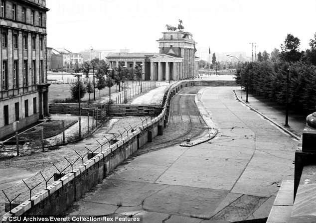 Later (1961), the Berlin Wall was constructed physically separating