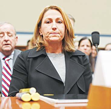 BUSINESS 32 Mylan CEO Heather Bresch pauses as she prepares to testify on Capitol Hill in Washington on Sept 21, before the House Oversight Committee hearing on EpiPen price increases.