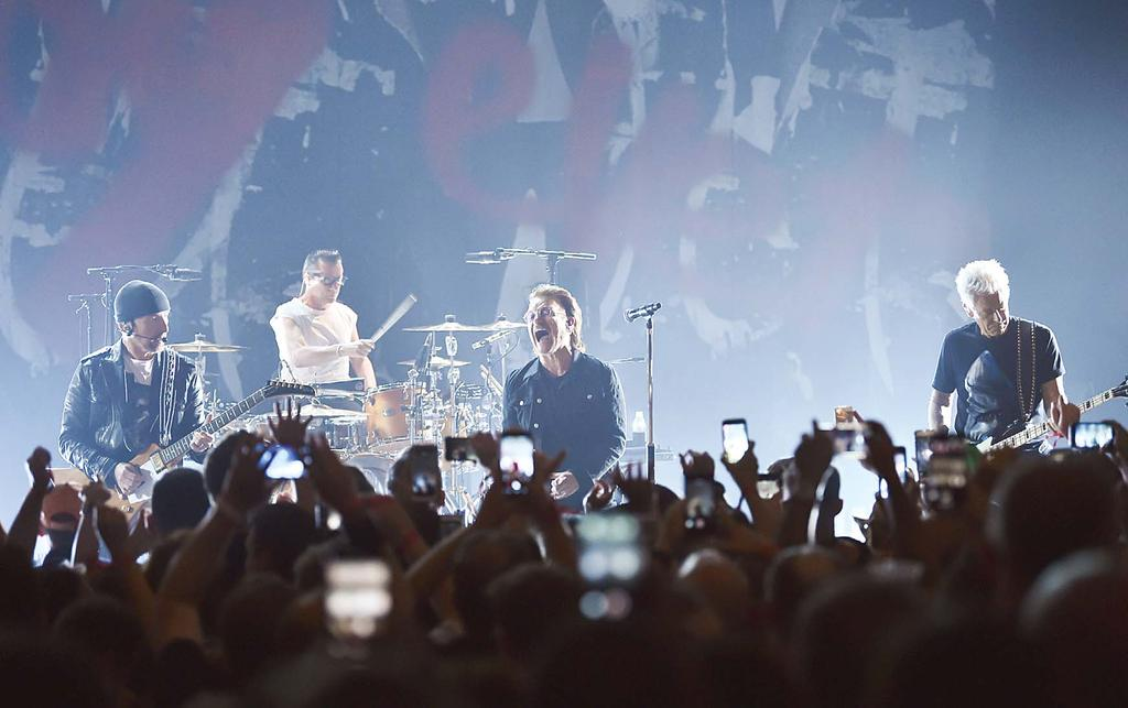NEWS/FEATURES 17 The Edge (left), Larry Mullen Jr, Bono and Adam Clayton of U2 perform during a concert at the Apollo Theater hosted by SiriusXM on June 11, in New York.