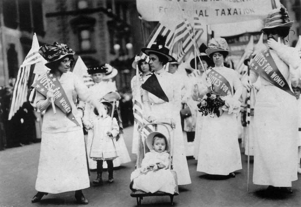 for the first time Some large stores had hung out the yellow suffrage flag and yellow daffodils were being worn by many in the crowd
