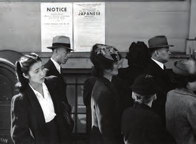 Chapter 27 Fighting the Good Fight in World War II, 1941-1945 809 Figure 27.14 Japanese Americans standing in line in front of a poster detailing internment orders in California.
