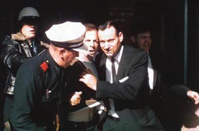 866 Chapter 29 Contesting Futures: America in the 1960s Figure 29.8 Lee Harvey Oswald (center) was arrested at the Texas Theatre in Dallas a few hours after shooting President Kennedy.