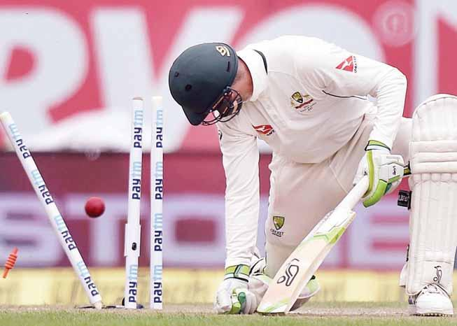 D ebutant left-arm wrist spinner Kuldeep Yadav's four wickets helped India skittle out Australia for 300 in their first innings on the opening day of the fourth and final cricket Test here on