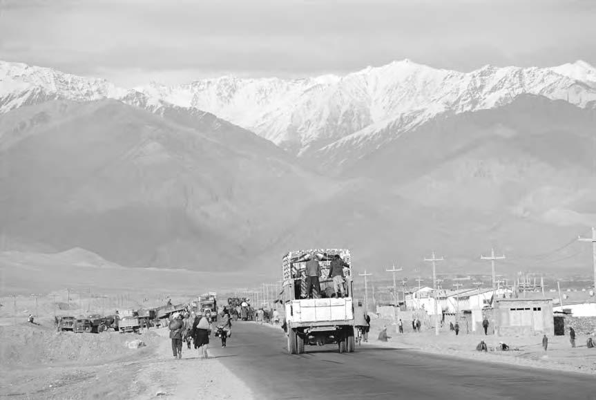 110 HOSHIMIAN, SAYYID KALILULLAH Travelers on a highway near Hindu Kush (Carl and Ann Purcel/Corbis) northern Afghanistan.
