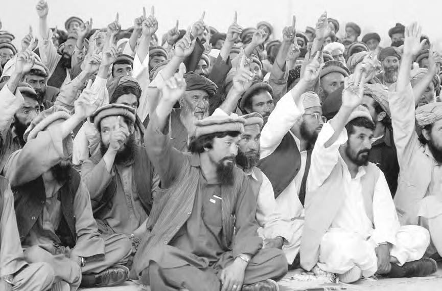 JOZJAN PROVINCE 135 Candidates elected in the first phase of Loya Jirga from the four districts of Parwan Province, North of Kabul, raise their hands before a vote during a meeting to elect a leader