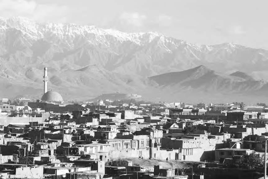 138 KABUL CITY Snow-capped mountains of the Hindu Kush range surround the Afghan capital of Kabul.