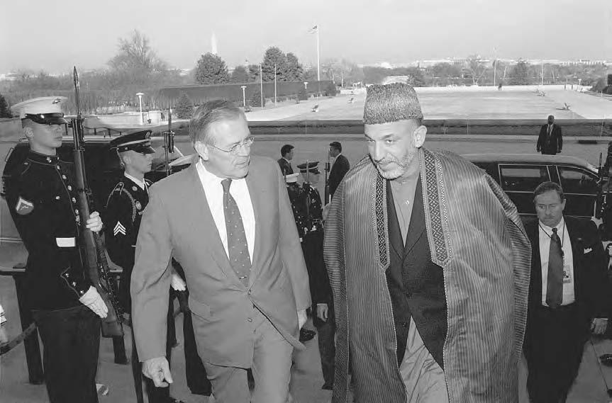 KARZAI, HAMID 143 Secretary of Defense Donald H. Rumsfeld (left) escorts Chairman of the Afghan Interim Administration Hamid Karzai through an honor cordon and into the Pentagon on 28 January 2002.