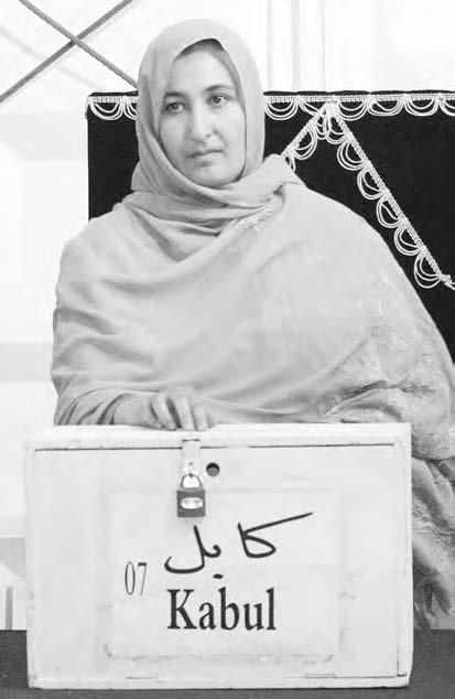 158 LOYA JIRGA Masooda Jalal, 34, an Afghan medical doctor and the only female candidate, votes during the traditional Afghan grand assembly, or Loya Jirga, in Kabul, 13 June 2002.