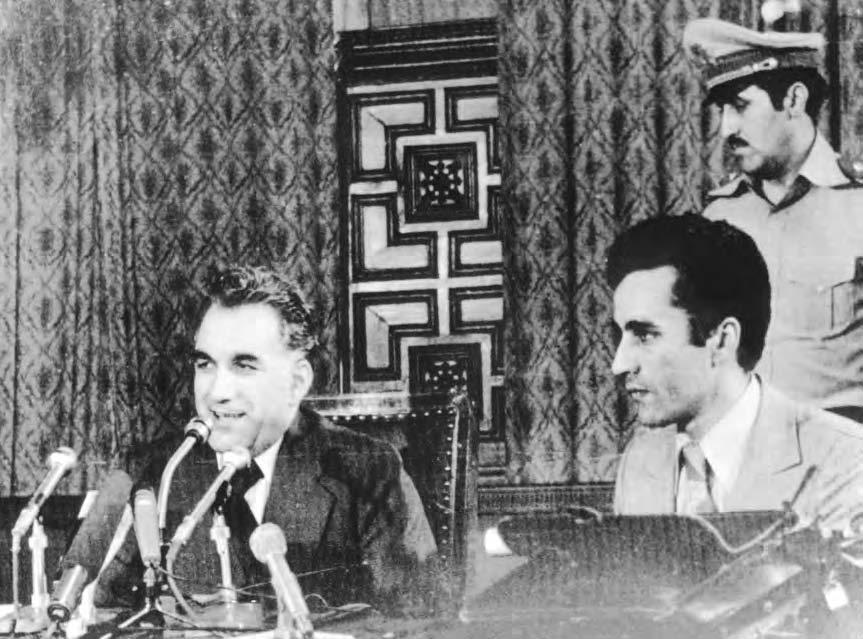 30 AMIR, MUHAMMAD President Hafizullah Amin (L) addresses a press conference nine days after taking power.