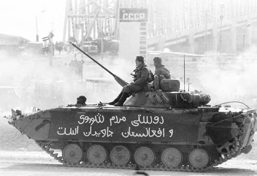 48 CIVIL WAR A Soviet tank crosses the Friendship Bridge linking the USSR and Afghanistan over the Amu Daria River. (Reuters NewMedia Inc.