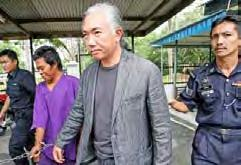 4 million displaced when typhoon Haiyan packing Photo: AFP Malaysian wildlife trafficker Anson Wong (centre) being escorted by the police at the sessions court in Sepang, outside Kuala Lumpur in 2010.