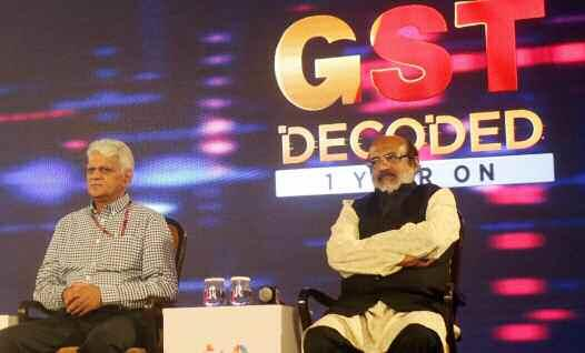 Cabinet Ministers from Kerala and Goa - Thomas Isaac (right) and Mauvin Godinho (left) respectively, during a panel discussion on 'GST Decoded 1 Year On', in New Delhi.