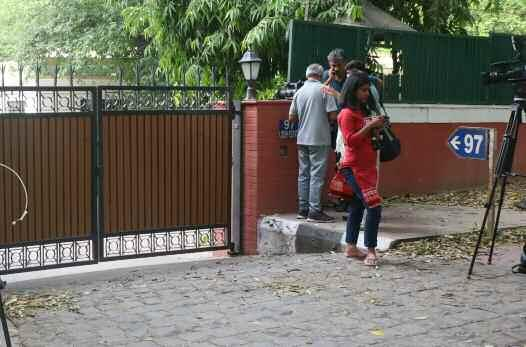 "Media personnel outside Congress MP Shashi Tharoor's residence in New Delhi. ""They are charging him for abetment of suicide. At least, he has been charged for criminality."