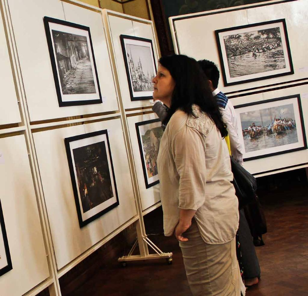 www.mmtimes.com the pulse 41 Photographs, from 100 years apart, are attracting large crowds at the National Theater in Yangon.