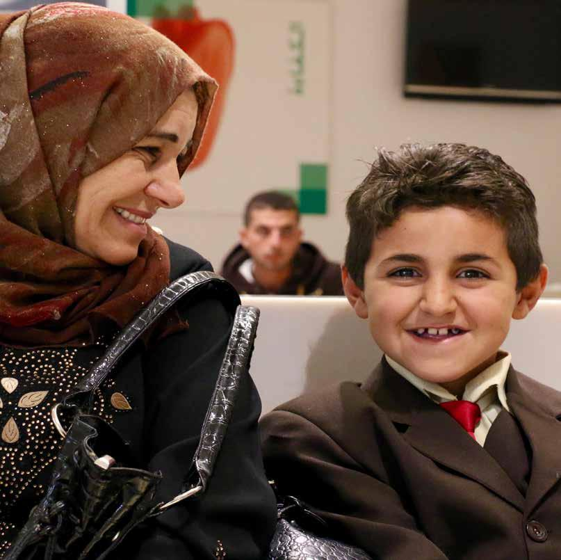 Noel and her son Abdullah receive humanitarian assistance from