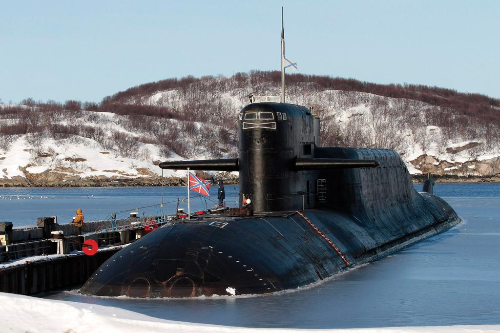 ELANA WILSON ROWE and HELGE BLAKKISRUD Learning to play nice: The nuclear submarine Yekaterinburg caught fire at a naval base in the Murmansk region of Russia in 2011.