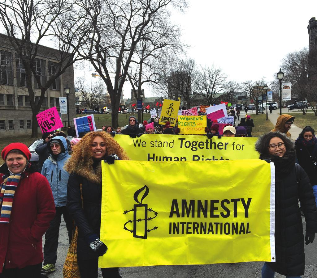 ca 1-800-565-9766 @GenPaul_ COVER PHOTO: Amnesty International activists gather in Toronto to express solidarity for refugees, at a time