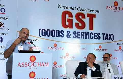 "Delhi Deputy Chief Minister Manish Sisodia addresses at ASSOCHAM National Conclave on GST in New Delhi. cellation cases among others continue to make GST a challenge for the sector""."